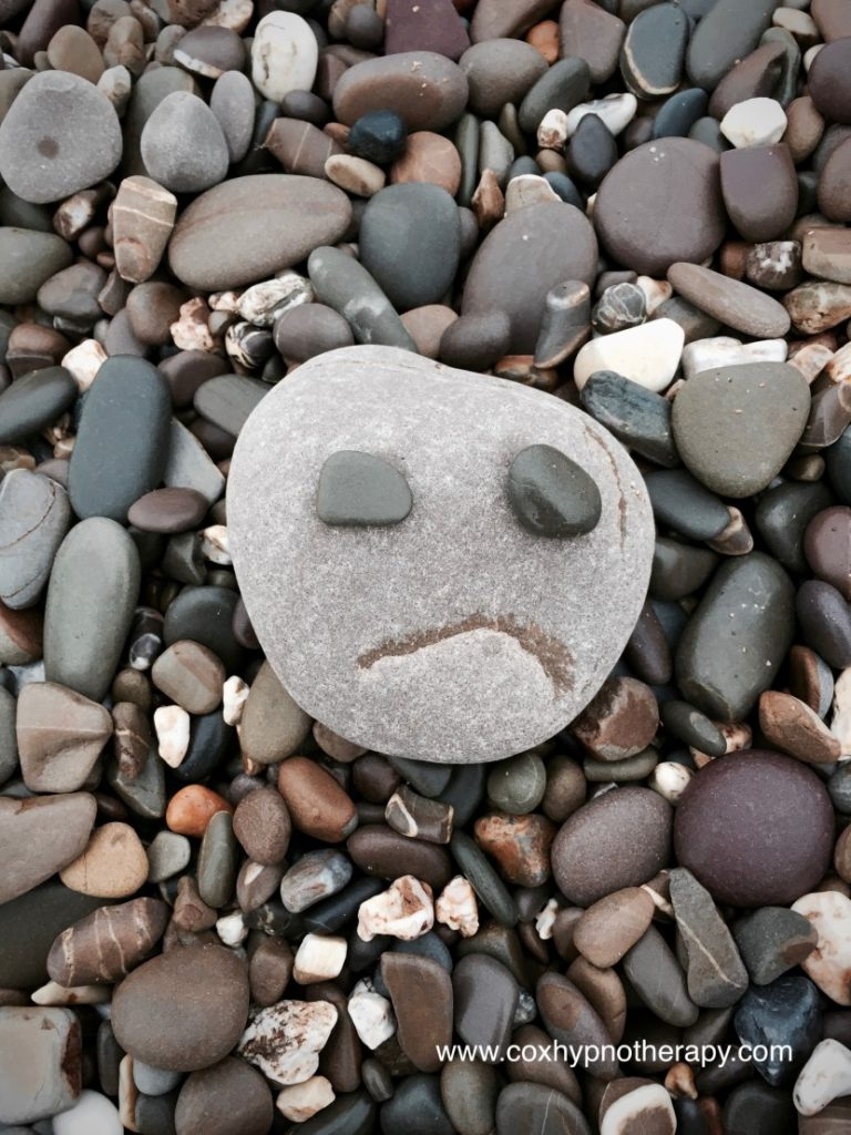 depressed image of stone for Neil Cox Hypnotherapy