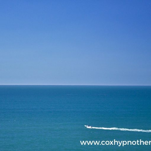 Distress to destress image of boat on water Neil Cox Hypnotherapy Cornwall