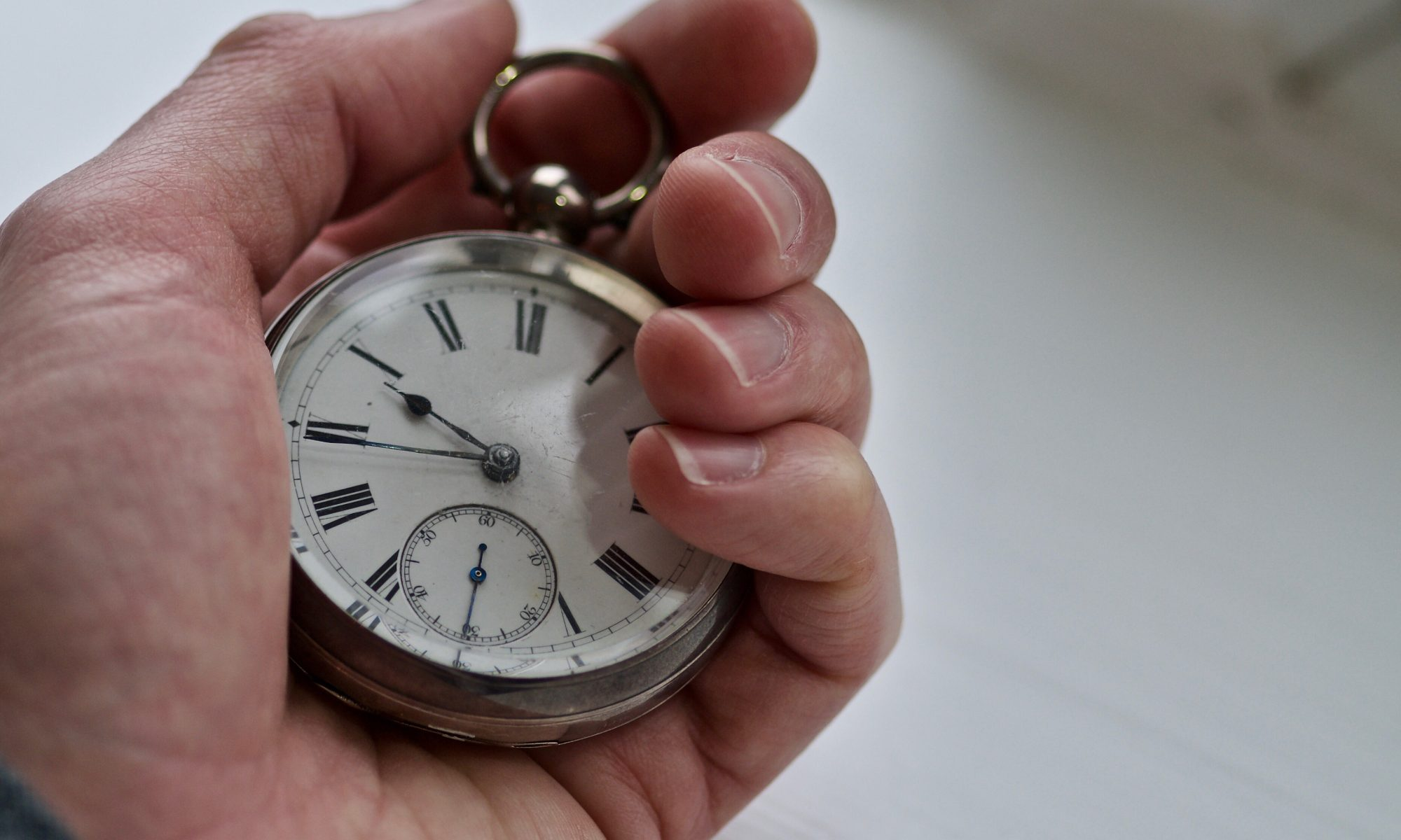Photo of Neil Cox hands holding a genuine antique Waltham fob watch whilst working at Neil Cox Hypnotherapy in Bude Cornwall